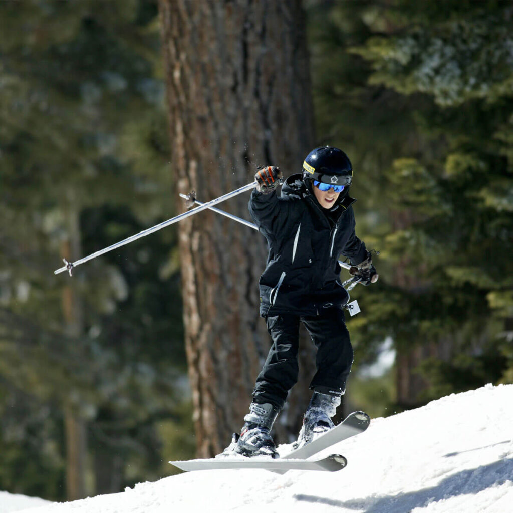Hitting the bumps while skiing at Mountain High Resort - Blue Angels Ski & Snowboard Program
